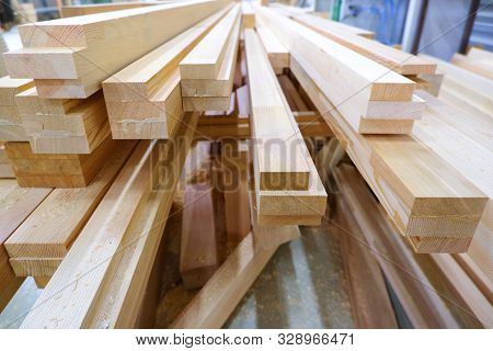 View from butt of stack of three-layer wooden glued laminated timber beams from pine finger joint spliced boards for wooden windows poster