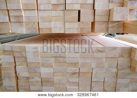 poster of End view of stack of two-layer wooden glued laminated timber beams from pine finger joint spliced boards for wooden windows