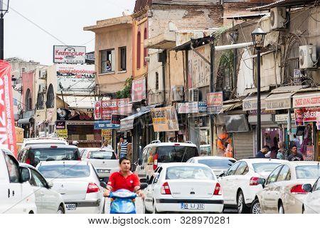 Adana, Turkey, 08.20.2014: View Of The Bustling Shopping Street Of Adana. Numerous Traffic Jams, Peo