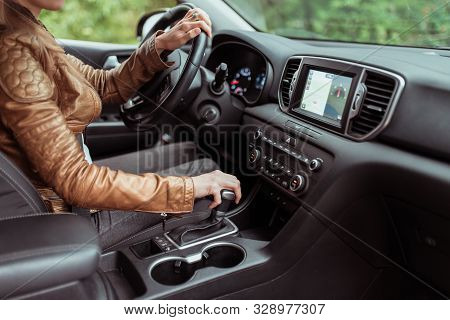 Woman In Summer Autumn, Driving Car, Parking Reversing, Engages Automatic Transmission. Start Moveme
