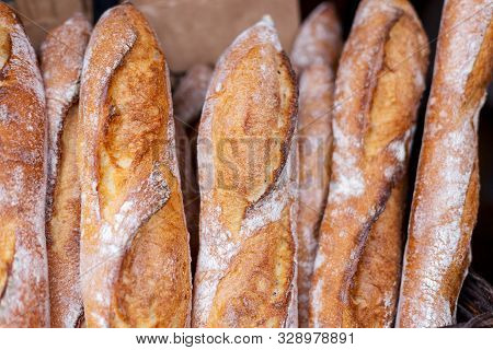 Fresh Tasty Baguettes On Street Food Market. Concept Of French Delicious Food
