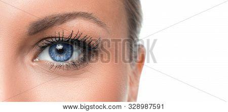 Close Up Photo Of A Womans Blue Eye. Eyesight Concept.