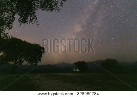 Landscape Of The Milky Way Galaxy With Starlight Over The Mountain With Tree At Kanchanaburi Provinc