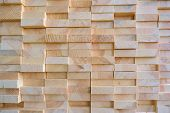Stack of three-layer wooden glued laminated timber beams from pine finger joint spliced boards poster