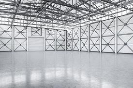Empty Spacious Warehouse Corner With Closed Door