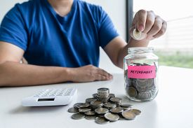 Man Putting Coins To Planning Growing Saving To Strategy With Money Box For Future Plan Fund Of Trav