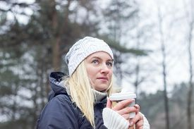 Smiling  Blonde Girl Outdoors At Cold Autumn Day