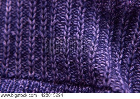 Violet Beautiful Knitted Bright Fabric As Background. Copy Space. Needlework As Background