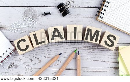 Claims Text On Wooden Block With Office Tools On Wooden Background