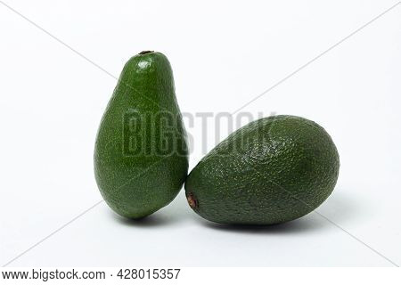Two Whole Avocados On A White Background. Isolated Green Avocado.