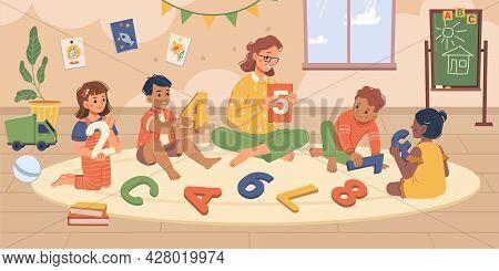 Kindergarten Children And Teacher On Classes. Educator And Children In Playroom, Tutor Explaining Nu