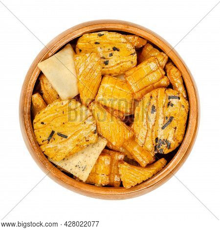 Senbei, Japanese Rice Crackers, In A Wooden Bowl. Also Sembei, Crispy, Bite-sized And Savory Snacks,