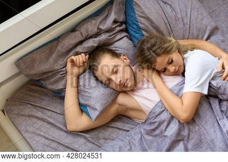Couple Is Sleeping In Bed. Recovery And Healthy Sleep Concept.