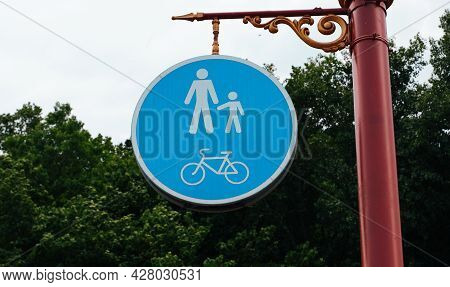 Road Sign On The Post. Walking And Cycling Area. Bicycle And Pedestrian Lane Road Sign On Pole Post,