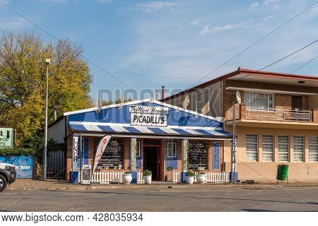 Middelburg, South Africa - April 22, 2021: A Street Scene, With The Picadillis Coffee Shop, In Midde
