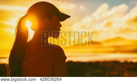 Woman silhouette profile walking outside looking away to the side with motivation. Healthy active lifestyle woman outside . Life goal aspirational challenge.