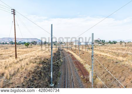Railway Line At Rosmead Railway Station Near Middelburg In The Eastern Cape Province. Storage Tanks