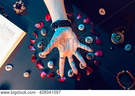 The Concept Of Divination And Magic. A Female's Hand Conjures Stones With The Signs Of The Zodiac, L