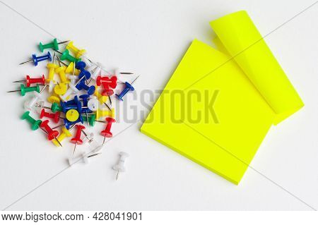 Sticky Notes And Pushpins On White Background. School Concept.