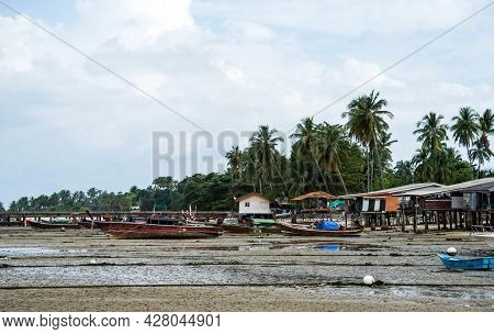 Fisherman's Fishing Boat On Sand At A Fishing Village Beach,stranded Fishing Boat After The Sea Has