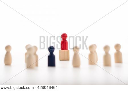 The Red Wooden Figure Standing On The Box Show Influence And Empowerment. Concept Of Business Leader