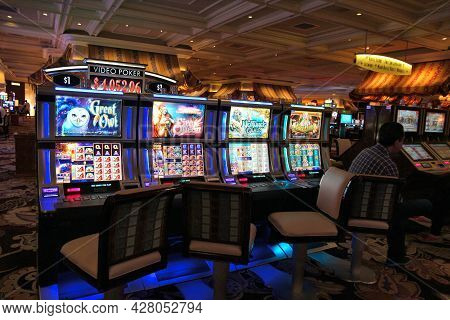 Las Vegas, Usa - April 14, 2014: People Play At Bellagio Resort In Las Vegas. The Famous Casino Reso