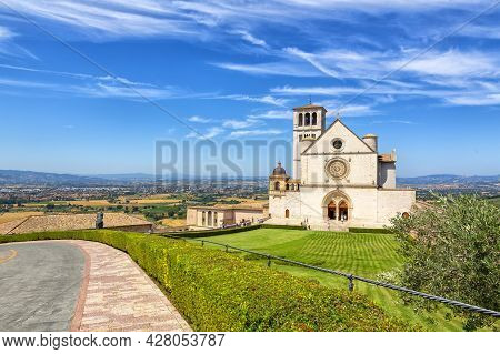 Beautiful Exterior View Of The Famous Papal Basilica Of St. Francis Of Assisi