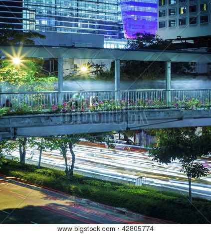 Pedestrian bridge over night street
