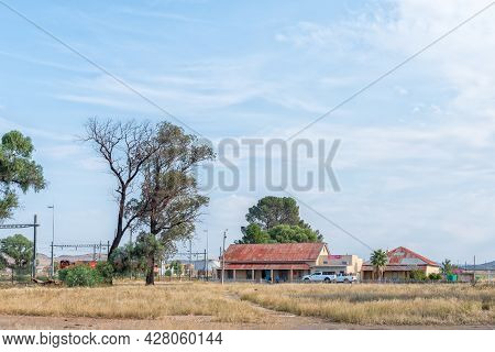 Rosmead, South Africa - April 22, 2021: A Butchery And A Supermarket At Rosmead Railway Station Near