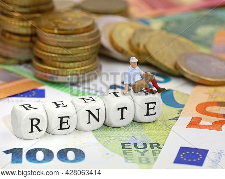 Miniatur Old Man Sitting On Letter Cubes Rente, The German Word For Pension, With Euro Money Bankote
