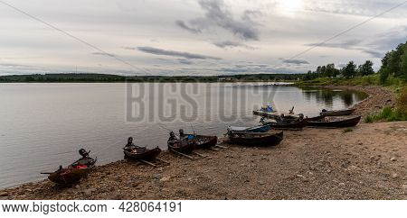Panorama View Of Many Wooden Motorboats Used For Salmon Fishing On The Banks Of The Tornionjoki Rive
