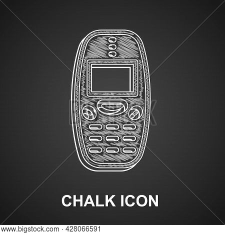 Chalk Old Vintage Keypad Mobile Phone Icon Isolated On Black Background. Retro Cellphone Device. Vin