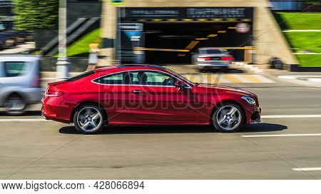 Moscow, Russia - July 2021: Red Premium Class Sedan Mercedes C-class C205 Coupe At The City Street