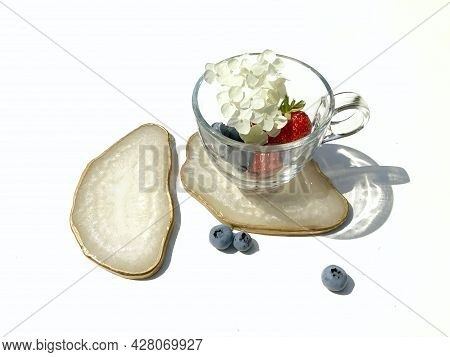 White Shimmer Pearl Coasters Of Epoxy Resin With A Golden Edge, Ripe Red Strawberries, Blueberries A