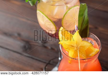 Alcoholic And Non Alcoholic Cocktails On Wooden Table. Summer Cold Drinks