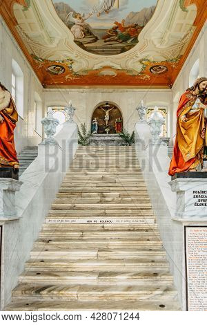 Kraliky, Czech Republic - July 12,2021. Mountain Of Holy Mother With Baroque Hedec Monastery And Hol