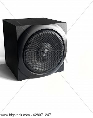 A Large Square Black Subwoofer In A Wooden Casing With A Metal Grill Stands Against A White Backgrou