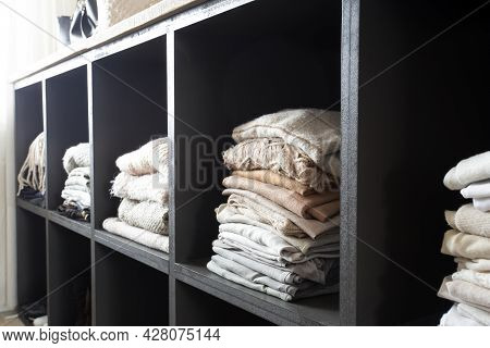 Open Wardrobe With Lots Of Folded Clothes, Organized Closet With Piled Up Clothes Modern And Clean I