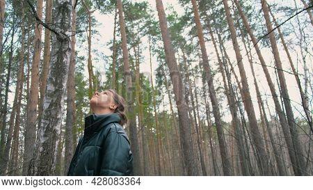 Beautiful Young Woman Walks Through Green Forest. Action. Beautiful Woman In Jacket Walks Through Fo