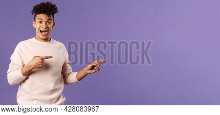 Portrait Of Enthusiastic Lively Hipster Male 25s, Pointing Fingers Right Inviting Join Courses, Sign