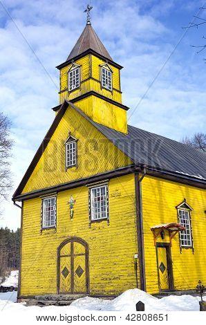 Silenai Wooden Yellow Church Facade, Vilnius District, Lithuania
