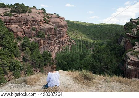 Caucasian Woman 40-50 Seen From Her Back Looking To A Beautiful Valley With Rocks And Forest In Teru