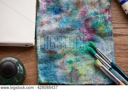 Painting brushes on a painters cloth. painting equipment  on an old painters desk.