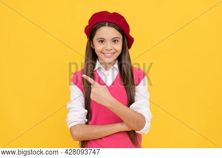 Teenage Beauty. Tween And Youth. Casual Fashion. Happy French Teen Girl Pointing Finger.