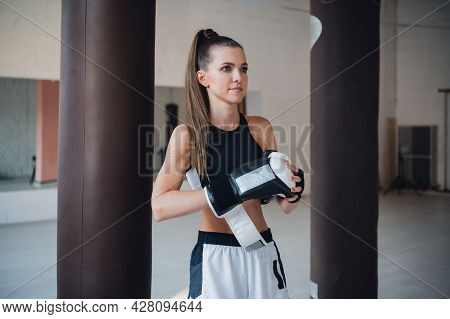Female Fighter Trains Her Punches, Training Day In The Boxing Gym, The Girl Trains A Series Of Punch