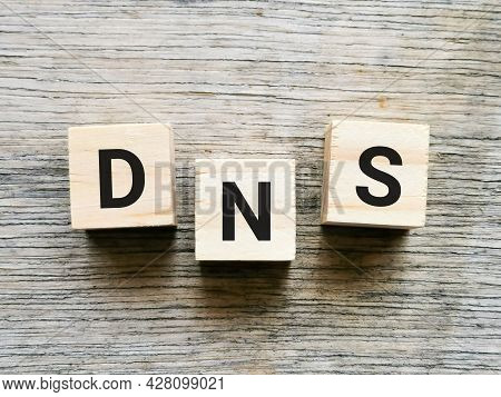 Phrase Dns On Wooden Cubes Isolated On Wooden Background.