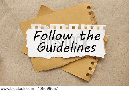Follow The Guidelines, White Torn Paper On Brown Torn Paper Background. Craft Background