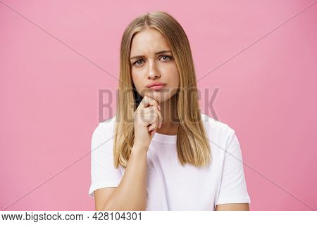 Girl Facing Problem Thinking Being Hesitant While Making Decision Holding Hand On Chin Frowning Purs
