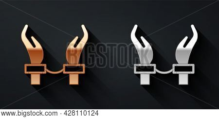 Gold And Silver Handcuffs On Hands Of Criminal Man Icon Isolated On Black Background. Arrested Man I