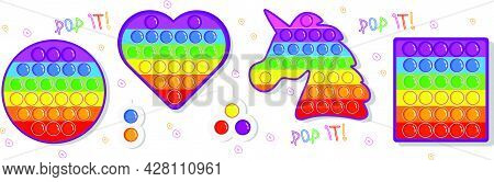 Simple Dimple. A Set Of Popular Pop Toys In Rainbow Colors And A Simple Handmade Toy With Dimples. A